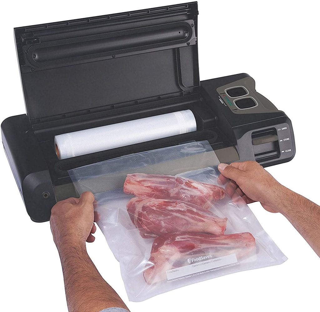 Vacuum sealer with built in bag storage and cutter